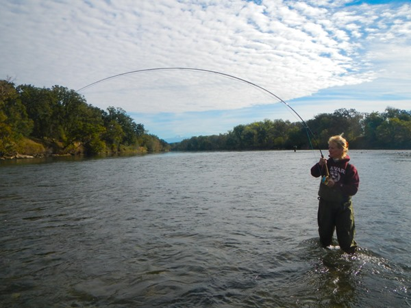 Sherrie with a steelhead on the end of the line