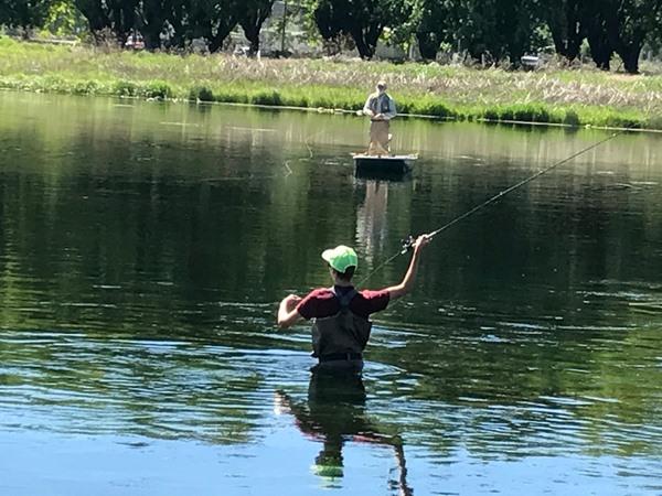 Ian working hard casting to risers on Baum Lake.  Pretty good form!