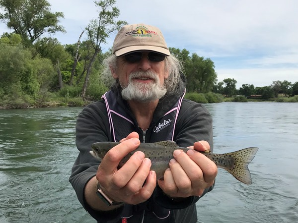 John with his first rainbow on a fly!