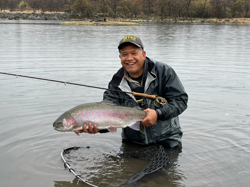 Tony fooled this nice trout on a dark colored streamer.