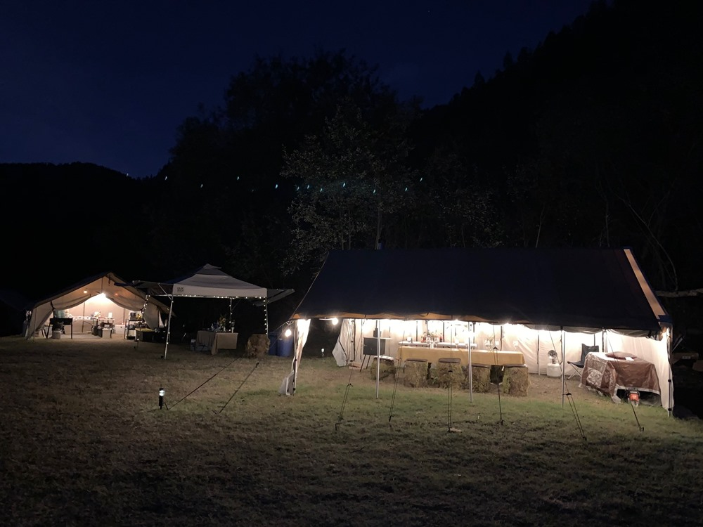 Camp lit up at night