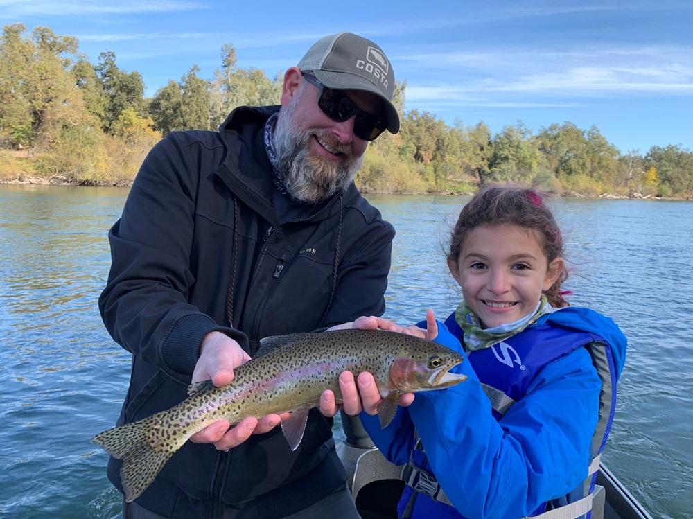 Mackenzie helping her dad