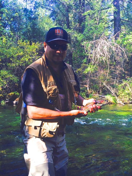 Koji's first fish of the day on a dry fly