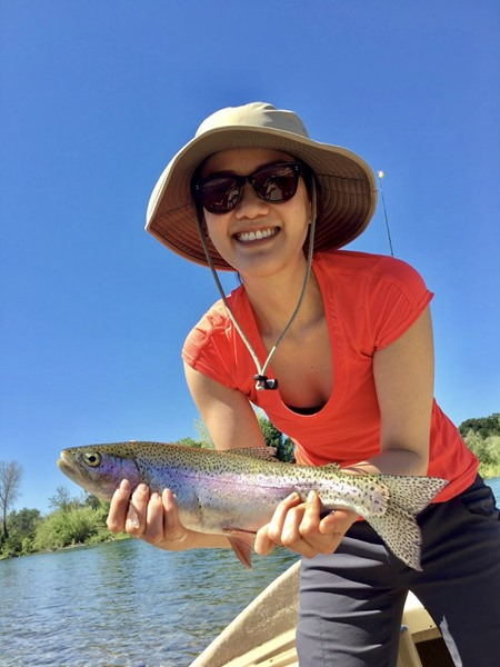 Marissa posing w her first rainbow trout!